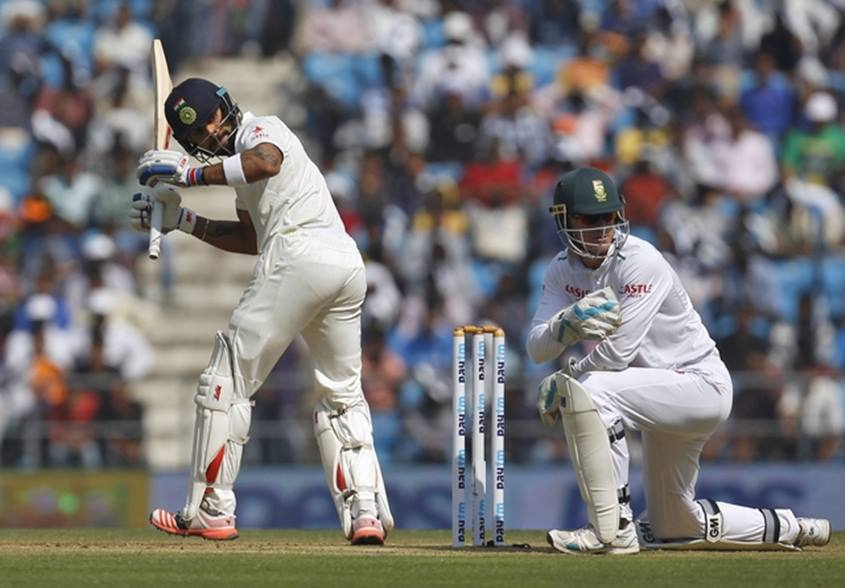 India's captain Virat Kohli , South Africa's wicketkeeper Dane Vilas, first day of third test cricket match in Nagpur, India, November 25, 2015.