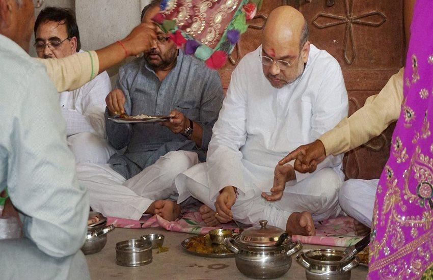 Amit Shah, BJP, Dalit Vote Bank, Sanjay Paswan, Kumbh Snan, Food With dalit, Stay at Dalit home, Casteism, Uttar Pradesh, UP Elections, India News