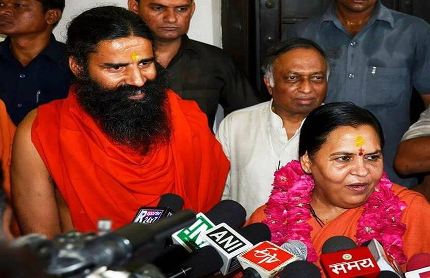 Uma bharti, baba ramdev, ganga, tussle between Uma bharti and baba ramdev, river ganga cleaning programme, Nitin gadkari, Hindi news, News in Hindi, Jansatta