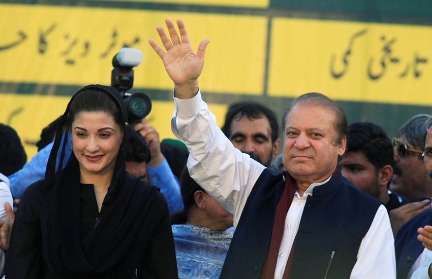FILE PHOTO: Nawaz Sharif, former Prime Minister and leader of Pakistan Muslim League, gestures to supporters as his daughter Maryam Nawaz looks on during party's workers convention in Islamabad