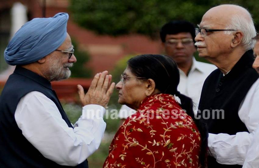 Former prime minister Manmohan Singh with BJP leader LK advani with wife Kamla Advani at an At Home in 2012. (Source: Express photo by Prem Nath Pandey